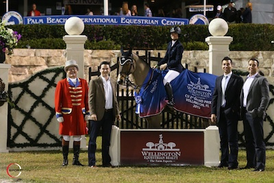 Reed Kessler and Ligist in their winning presentation with ringmaster Cliff Haines and Matt Varney and Rob and Chris Desino of Wellington Equestrian Realty. Photo © Sportfot.