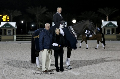 David Marcus receiving the Champion Equine Insurance Dressage Style Award with Michael Stone of Equestrian Sport Productions and Laura Whitlow of Champion Equine Insurance. Photo © SusanJStickle.com