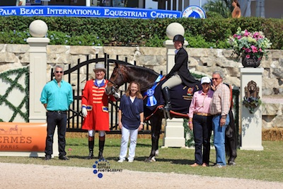 Praise and Sheila Motley in their winning presentation with Chuck Mayer of Blue Ribbon Blankets, ringmaster Cliff Haines, Carol Cone, and Selma and Ken Garber.  Photo © Anne Gittins Photography.