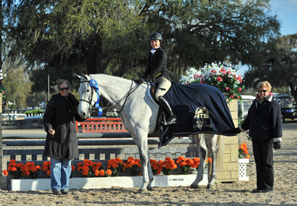 ©ESI Photography Sophia Lothrop and Castell are awarded winner's honors after the $1,500 Hunter Prix at HITS Ocala.