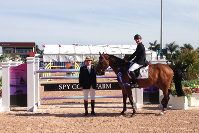 Johannes Ehning and Cayenne 162 in their winning presentation with ringmaster Cliff Haines.