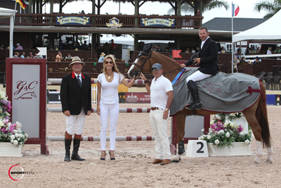 Eric Lamaze and Wang Chung M2S in their winning presentation with ringmaster Cliff Haines and Gustavo and Carolina Mirabal of G&C Farm. Photo © Sportfot.