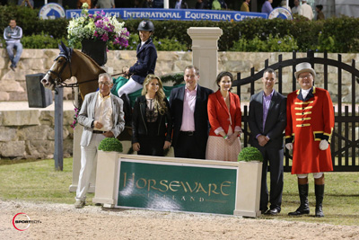 Eiken Sato and Espyrante in their winning presentation with Tom MacGuinness, Lorraine MacGuinness, Ciaran Herr, Emma Ferguson, and Kelly Nicolls for Horseware Ireland and ringmaster Cliff Haines. Photo © Sportfot.