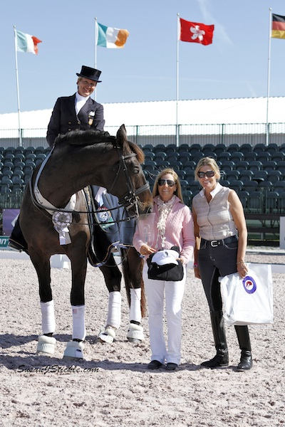 Tina Konyot and Calecto V with Laura Whitlow of Champion Equine Insurance and Ashley Holzer of Today's Equestrian