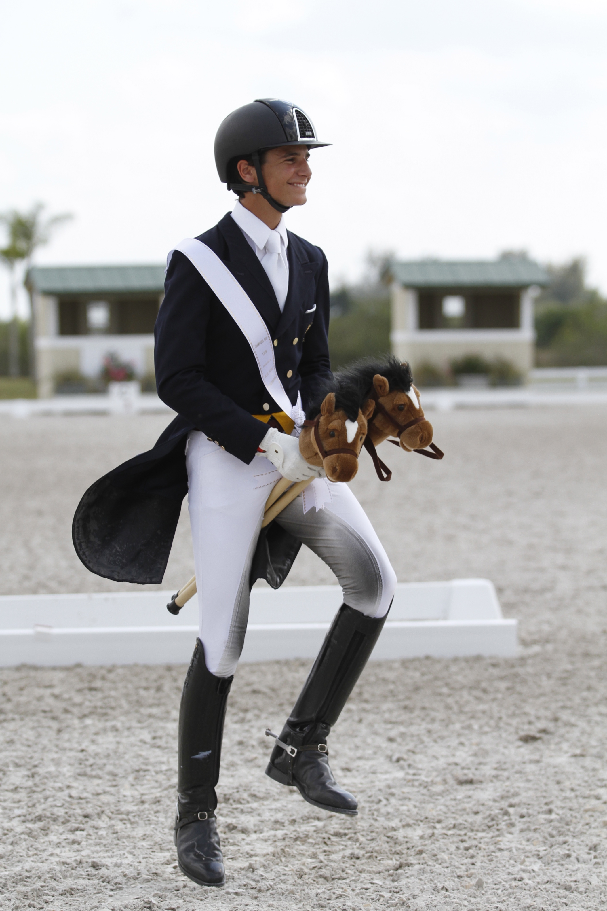 Juan Matute, Jr., rides not one, but two horses in the awards ceremony