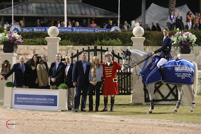 Daniel Deusser and Cornet d'Amour in their winning presentation with Richard Schechter, Chairman and CEO of The Bainbridge Companies with his executive team, Mark and Katherine Bellissimo, and ringmaster Cliff Haines. Photo © Sportfot.