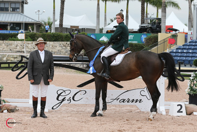Darragh Kenny and Delilah in their winning presentation with ringmaster Cliff Haines. Photo © Sportfot.