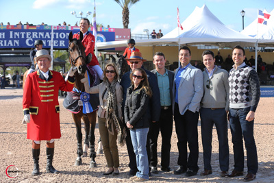 Kent Farrington and Blue Angel in their winning presentation with ringmaster Cliff Haines, owner Robin Parsky, Equestrian Sport Productions' President Michael Stone, along with Courtney Varney, Brandon Osbourne, Chris Desino, Matt Varney and Rob Desino representing Wellington Equestrian Realty. Photo © Sportfot.