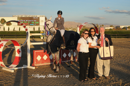 ©Flying Horse Photography Meredith Michaels-Beerbaum and Malou are presented with top prizes after winning the $50,000 HITS Grand Prix, presented by Zoetis, at HITS Thermal.