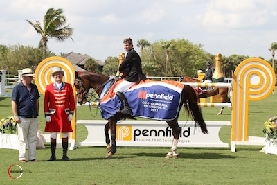 Shane Sweetnam and Solerina in their winning presentation with Equestrian Sport Productions' President Michael Stone and ringmaster Cliff Haines.  Photo © Sportfot.