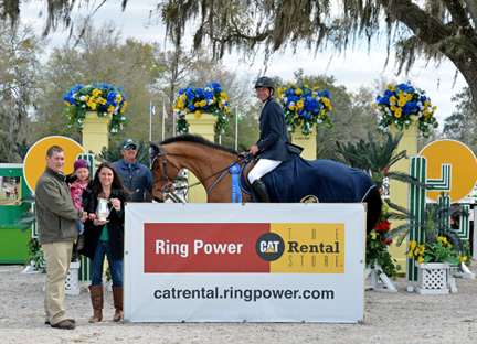 ©ESI Photography.  Sam, Nicole and daughter Kate Love, joined Derek and Jared Petersen in the winner's circle after Jared and Titus 2:11 captured the win in the $50,000 Ring Power Grand Prix, presented by Zoetis.