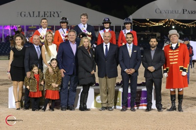 The winning U.S. team: Kent Farrington, Beezie Madden, Chef d'Equipe Robert Ridland, Reed Kessler, and Laura Kraut with Gustavo and Carolina Mirabal and their daughters Maria Emilia, Andrea Carolina and Victoria Elena, Mark and Katherine Bellissimo, John Madden, HH Prince Faisal Al Shalan, and ringmaster Cliff Haines.  Photo © Sportfot.