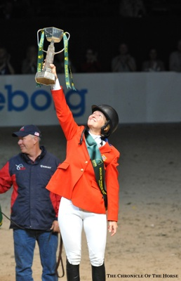 Beezie Madden holds the Rolex FEI World Cup Finals trophy