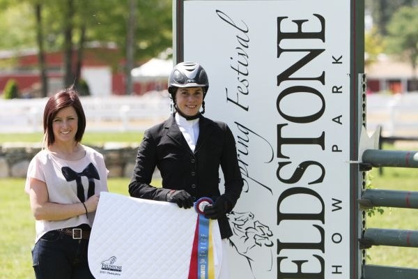 Emily Bickford was presented with the High Junior/Amateur-Owner Jumper Championship at the Fieldstone Spring Festival.