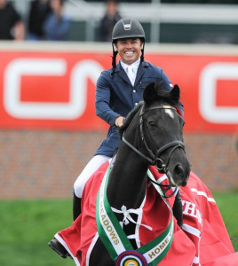 Kent Farrington was all smiles in his victory gallop. Photo © Spruce Meadows Media Services.