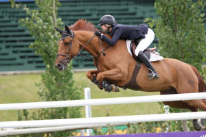 Abigail McArdle and Cosma 20. Photo © Spruce Meadows Media Services.