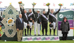 The winning Irish team - Darragh Kerins, Richie Moloney, Chef d'Equipe Robert Splaine, Conor Swail, and Cameron Hanley – with John Madden and Linda Southern-Heathcott. Photo © Spruce Meadows Media Services.