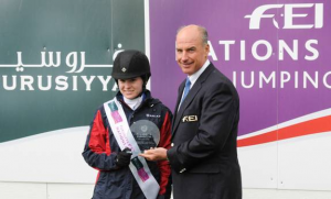 Katie Dinan was honored with the Furusiyya Rider of the Day award, presented by John Madden,  Chairman of the FEI Jumping Committee. Photo © Spruce Meadows Media Services.
