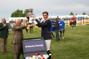 Quentin Judge raises his trophy and Husky for victory with Asim Ghosh, President & CEO of Husky Energy. Photo © Spruce Meadows Media Services.