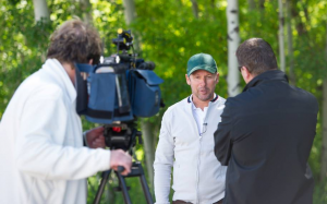Olympic gold medallist Eric Lamaze of Canada is interviewed by the media during Media Day at the 'National' Tournament. Photo Credit: Spruce Meadows Media