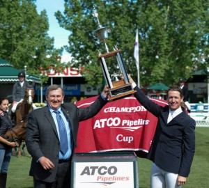 McLain Ward raises the trophy with Brendan Dolan, Sr. Vice President & General Manager, ATCO Pipelines. Photo © Spruce Meadows Media Services.