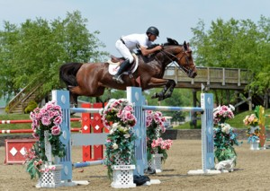 ©ESI Photography Todd Minikus and Quality Girl jumping their way to a win in the $25,000 SmartPak Grand Prix, presented by Zoetis, at HITS Saugerties.