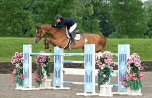 ©ESI Photography Agatha D'Ambra and Udiana jumping their way to a win in the $75,000 HITS Grand Prix, presented by Zoetis, at HITS Saugerties this weekend.