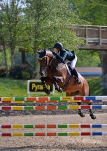 ©ESI Photography Ali Tritschler and Velinta Palo Blanca on their way to a win in the $5,000 Pyranha NAL Junior Jumper Low Classic.