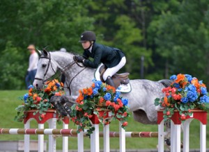 ©ESI Photography Lillie Keenan and Pumped Up Kicks jump their way to a win in the $125,000 Purina Animal Nutrition Grand Prix, presented by Zoetis, at HITS Saugerties over the weekend.
