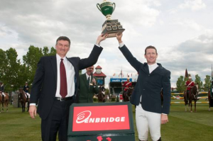 McLain Ward raises his trophy with Al Monaco, President & CEO of Enbridge Inc., as winner of the $33,000 Enbridge Cup.