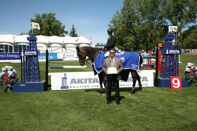 McLain Ward and Wannahave receive their trophy from Fred Hensel, Vice President of Marketing at AKITA Drilling. Photo © Spruce Meadows Media Services.