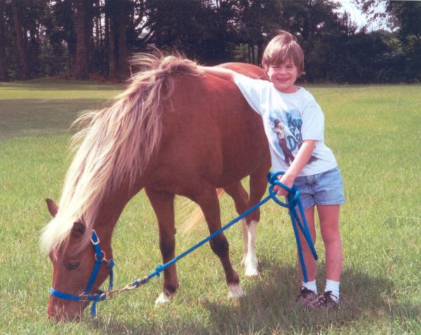 Andi, diagnosed with Wilm's Tumor, wished for a miniature horse of her own to love and take care of.