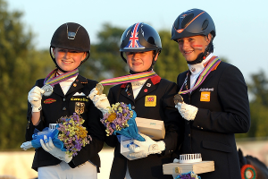 On the medal podium for Individual Dressage at the FEI European Pony Championships 2013 in Arezzo, Italy - (L to R) bronze medallist Lisanne Zoutendijk (NED), gold medallist Phoebe Peters (GBR) and silver medallist Semmieke Rothenberger (GER).  Photo: FEI/Helen Revington.