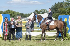 Paul O'Shea is presented with the Equestrian Estates Planning Group trophy for his Sunday victory at the Silver Oak Jumper Tournament - photo by Tammy Hardy.