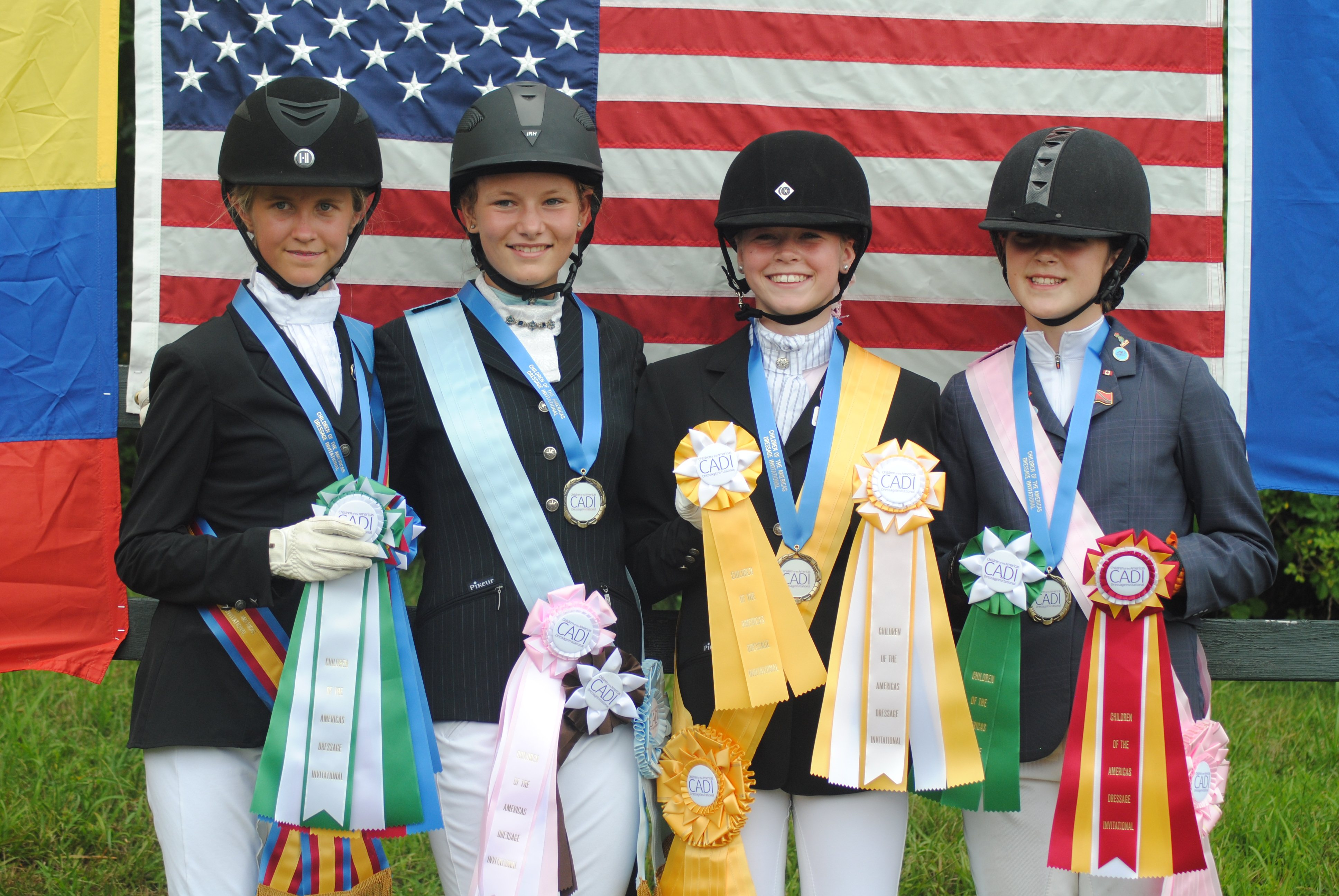 The riders who qualified for CADI to represent Dressage4Kids (D4K) stand together after the final awards ceremony. D4K's Youth Dressage Festival is a special qualifier for CADI, sponsoring a group of riders each year.