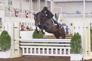 Jennifer Alfano and Candid captured the $1,500 USHJA Pre-Green Incentive Hunter Class at the 67th Buffalo International Horse Show with the high score of 87 points.