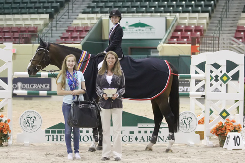 Reid Patton and Twisther in their winning presentation. Photo copyright Jennifer Wood Media, Inc.