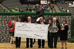 Tim Gredley accepts the top prize money, presented by Dr. Pearse Lyons of Alltech