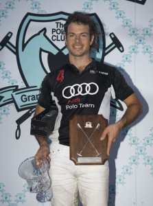 Audi Most Valuable Player Michel Dorignac has his arms full with awards and Beluga Vodka. Photo by Scott Fisher
