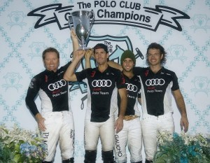 —Defending champions Audi hoist the winning trophy. From left to right Marc Ganzi (1), Nic Roldan (3), Carlitos Gracida (2) and MVP Michel Dorignac. Photo by Scott Fisher