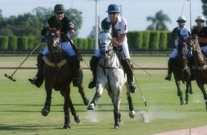 Casablanca's Mike Azzaro (3) and Palm Beach Equine's Luis Escobar (3) in a horse race to the ball. Photo by Scott Fisher