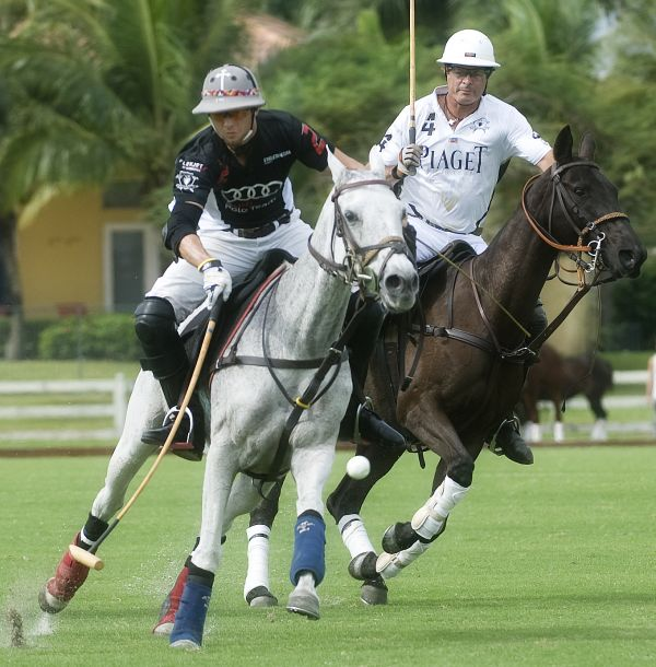 Piaget's Juan Bollini (4) and Audi's Carlitos Gracida (2) keep their eye on the ball. Photo by Scott Fisher