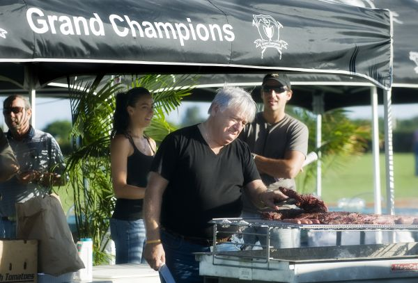 Fans working up an appetite watching Cilantro's Herman Moreira prepare asado sandwiches provided by Grand Champions. Photo by Scott Fisher