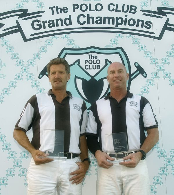 Officials Horton Schwartz and Dale Schwetz receive awards from Grand Champions Polo Club for a job well-done during the 20-goal tournament. Photo by Scott Fisher
