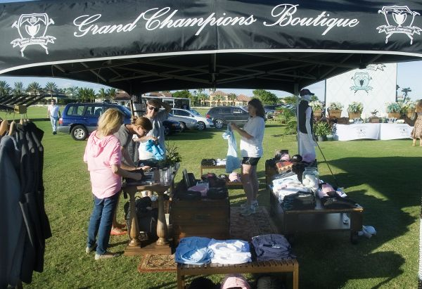 Retail manager Jennifer Guinan helps customers with their purchases in the Grand Champions Boutique. Photo by Scott Fisher