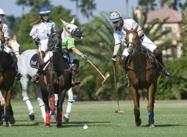 Grand Champions' Chase Schwartz (1) avoids the hook of Cipi Echezaretta of Polo School Green (2) while teammate Riley Ganzi (3) backs her up. Photo by Scott Fisher