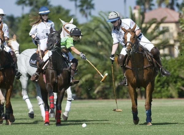 Grand Champions' Chase Schwartz (1) avoids the hook of Cipi Echezaretta of Polo School Green (2) while teammate Riley Ganzi (3) backs her up. Photo by Scott Fisher