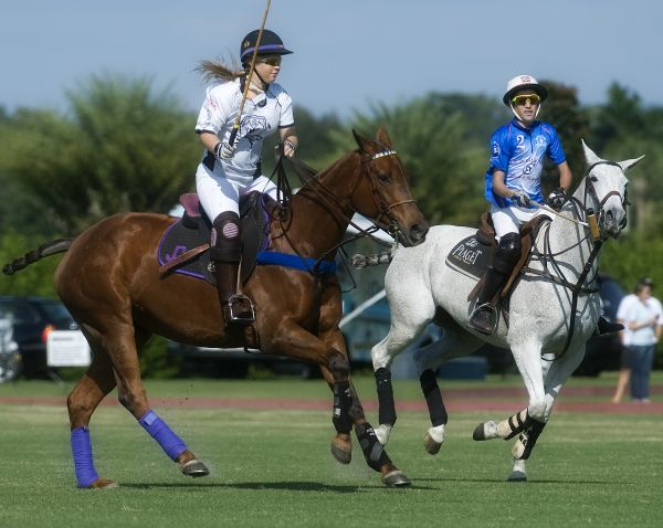 Grand Champions' Jacqui Casey (2) tries to outrace Matt Cohen of Polo School Blue (2) for the ball. Photo by Scott Fisher