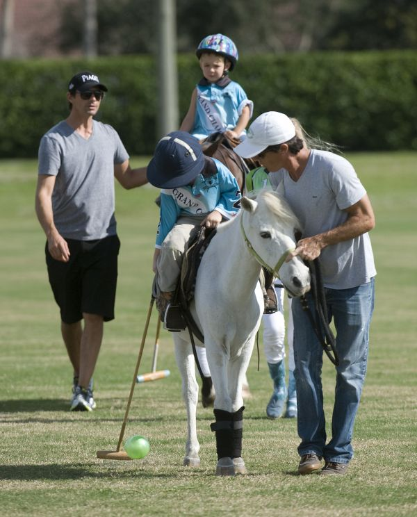 Luke Hall, 3, with his dad, professional polo player Jeff Hall, participating in the Pro Leadline in his debut. Photo by Scott Fisher