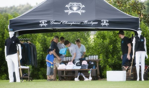 Parents and kids shopping at the Grand Champions Boutique. Photo by Scott Fisher